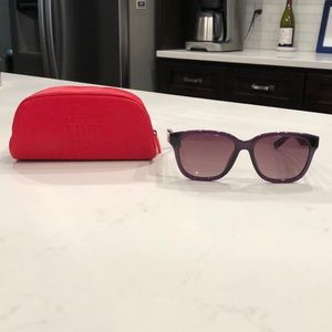 Purple Lacoste Live Sunglasses with red case